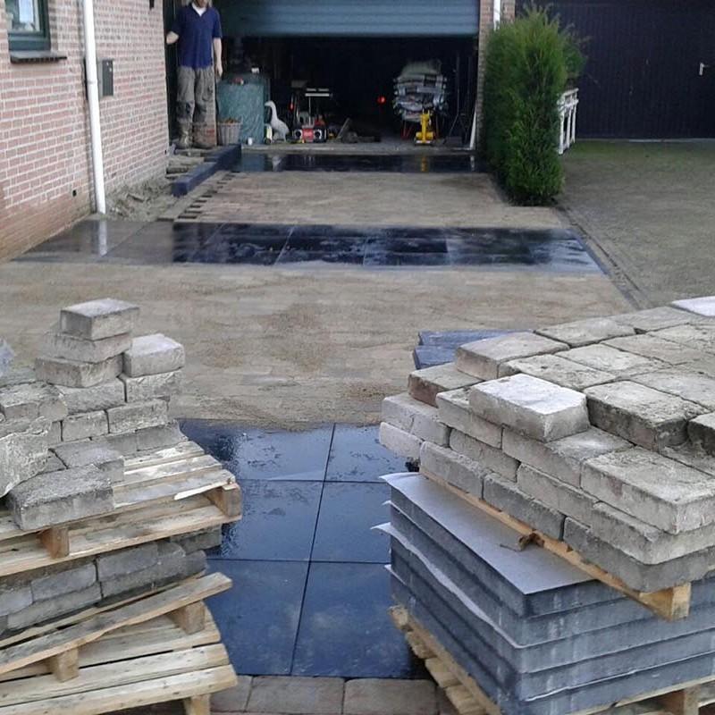 Renovatie oprit en achtertuin met deel van aanwezige materialen - 3 van 15