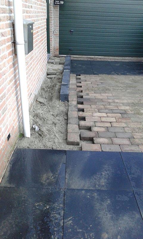 Renovatie oprit en achtertuin met deel van aanwezige materialen - 4 van 15